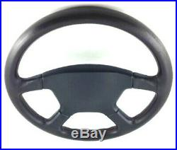 Genuine Momo Irmscher 4 spoke 380mm Black leather steering wheel. Rare 1992 7E